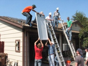 image of Installing Solar Panels on home roof